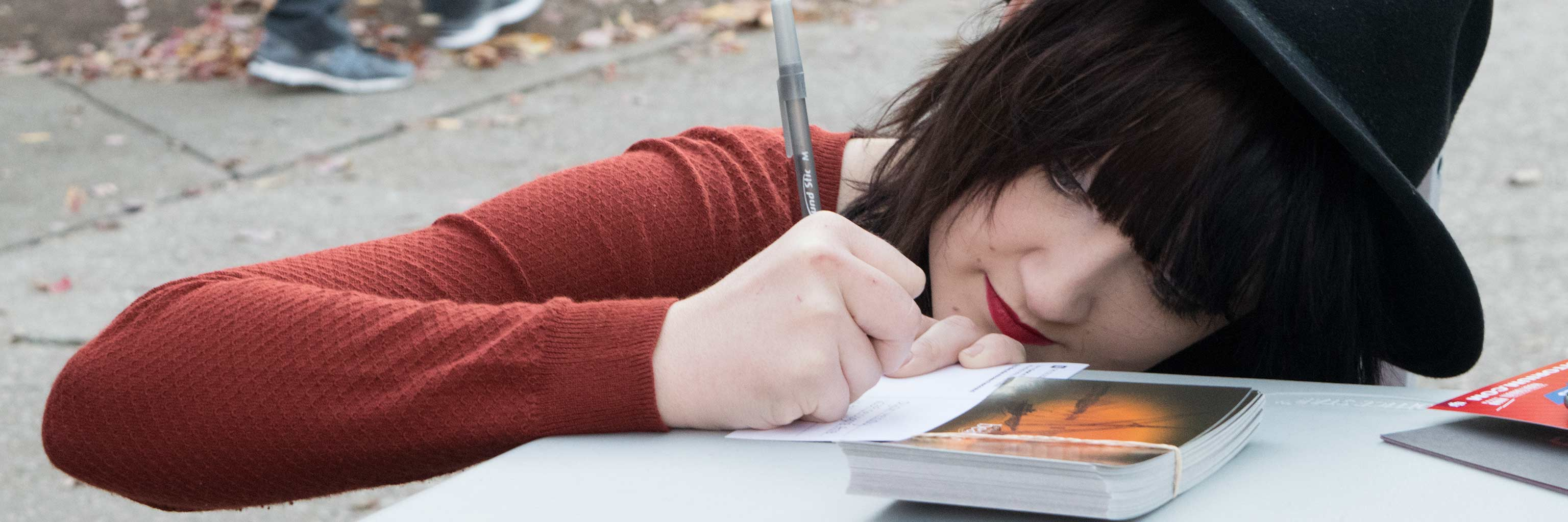 Girl writing on a piece of paper